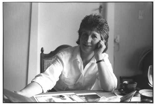 Fiona Kidman sitting at a desk as writer in residence at Victoria University.