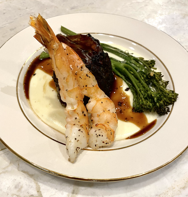 Braised Beef Over Whipped Potatoes With Prawns and Broccolini