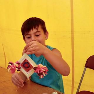 Child with Ojo de dios.jpg