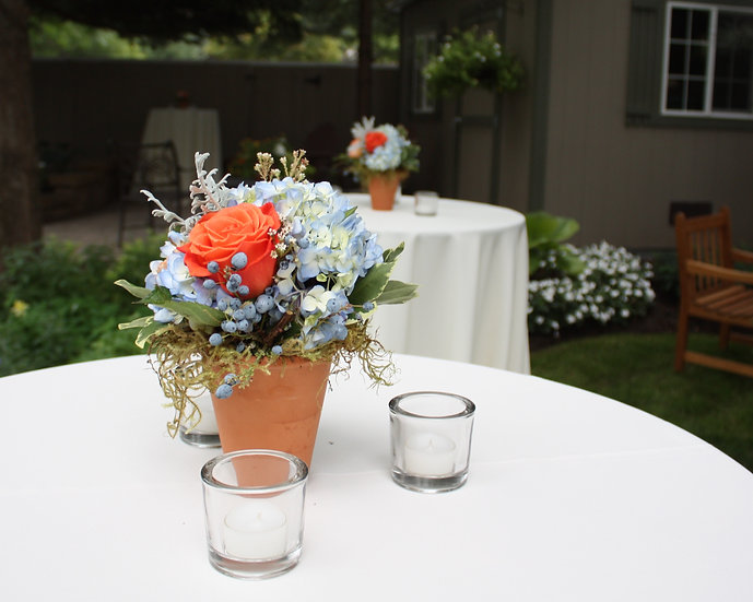 White Hydrangea and Orange Roses Table Arrangement