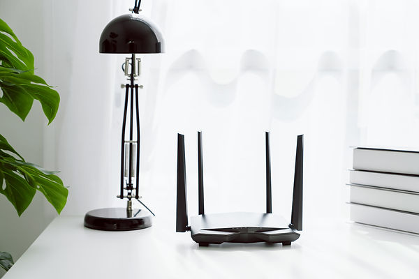 wifi-and-broadband-router-on-white-table