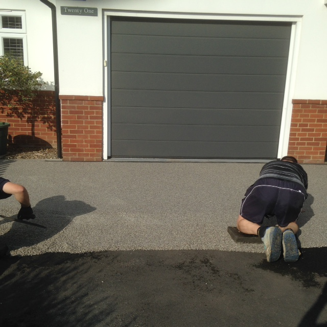 Kent Resin Bound Surfacing Contractors applying resin bound surfacing by hand