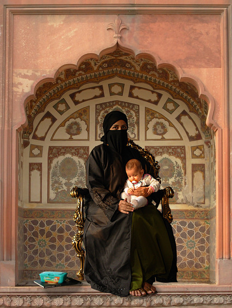 Maryam, 2006 Giclee Print on paper 101.5 x 129.5cm  A figure of importance in both Christian and Islamic traditions, Hammad modernises and Islamacises the image of the Virgin Mary. Challenging us to see beyond the burqa, Hammad highlights the transcendency of motherhood above culture and across time and space, drawing together the ethereal and the everyday. In both subject and composition, Hammad imitates the traditional Christian altarpiece; while the Virgin Mary is often flanked by (predominantly male) biblical figures, Maryam alone, accompanied only by her baby, book of erotic art and baby-wipes, commands our attention, reverence and awe.