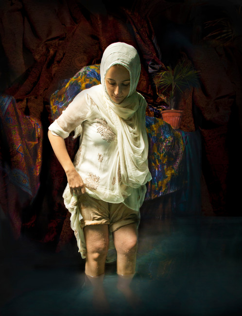 River of Smoke, 2012 Giclee Print on canvas, edition of 3  46.5 x 61cm  $2,100 AUD   The act of unveiling the Muslim woman is demystified in this artwork shaped after Rembrandt's A Woman Bathing in a Stream. Traversing back to the 17th century, Hammad enjoys limitless access to various canonic artworks, and here the gentle yet explicit femininity of the Muslim woman's body is explored. She asserts agency over herself and her body in the soft lifting of her kameez as she bathes her ankles, rejecting the expectations surrounding the appearance and veiling of the muslim body through this simple act.
