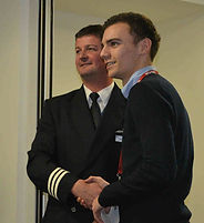 2014 Joel Bland receives his award from