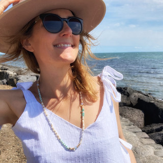 Emma co-founder Bleu Emeraude with Phone strap necklace natural beads