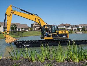 txd amphibious excavator working at town