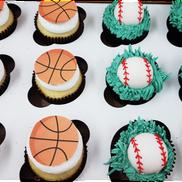 baseball and basketball cupcakes.png