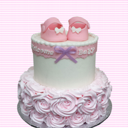 baby booties with rose piping 4.png