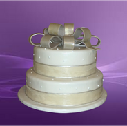 Gold top Bow wedding cake2.png