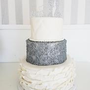 silver sequen wedding cake.png