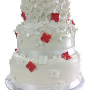 red accent flowers wedding cake.png