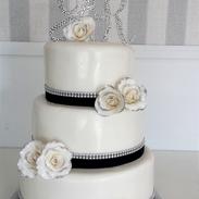 diamond trim black ribbon wedding cake.p