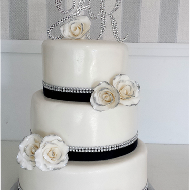 diamond trim black ribbon wedding cake.p