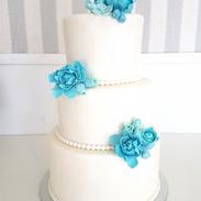 light blue peonies wedding cake.png