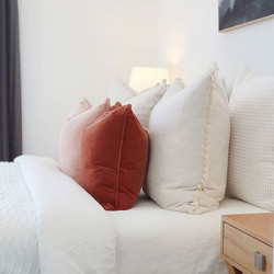Create mood with cushions and colour . .