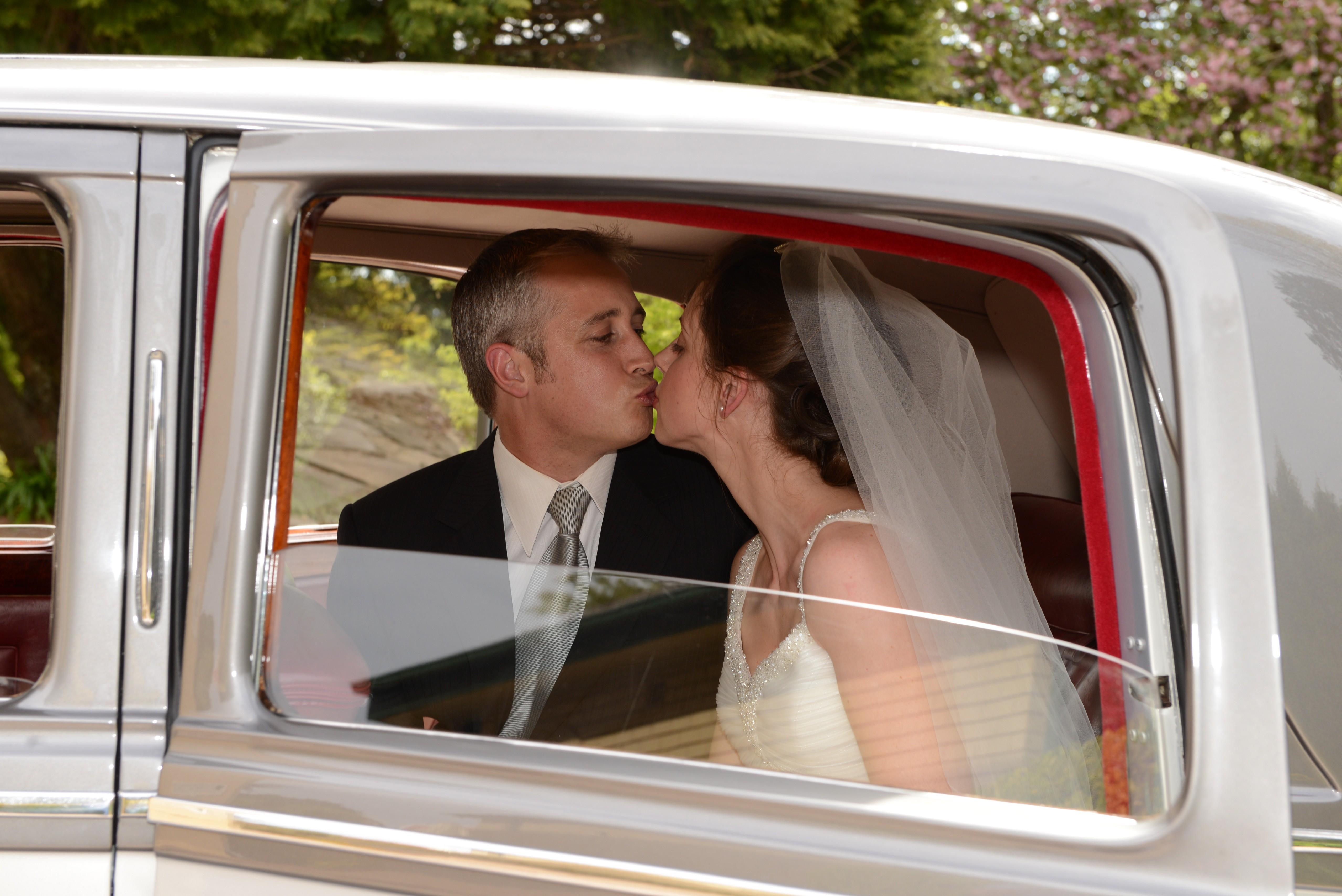Bride & groom in car