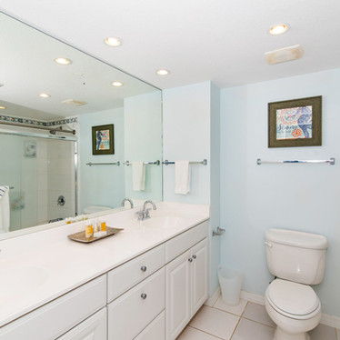 Master bath has two sinks, large tub and shower..