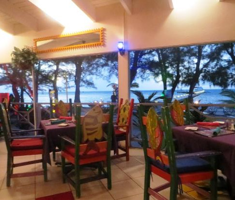 Eat at Rum Point Club next door