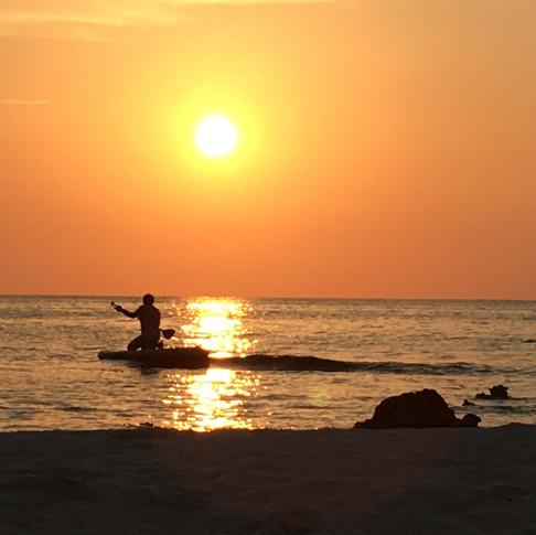 Paddleboard into the sunset.