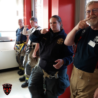 Learning to sign at Chatham School Fire Prevention Visit 2019