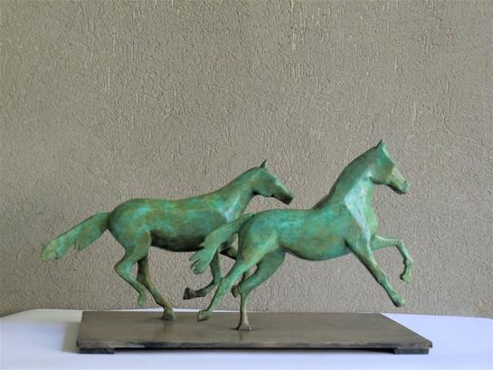 Galloping horses.