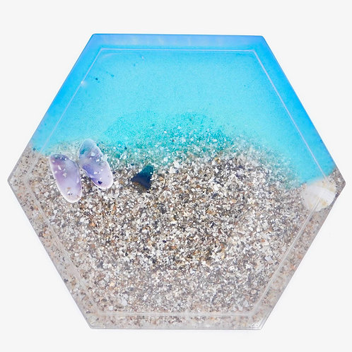 Handmade sea inspired sand and shell embedded in resin hexagon coaster with lip.
