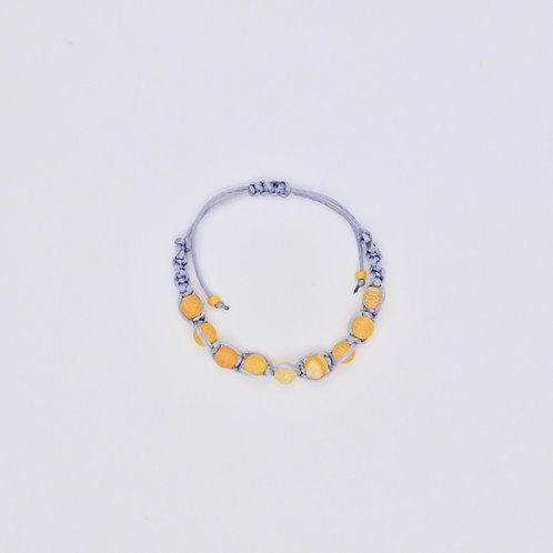Handmade bracelet in colors similar to Pantone color of the year 2021: Illuminating yellow and Ultimate Gray.