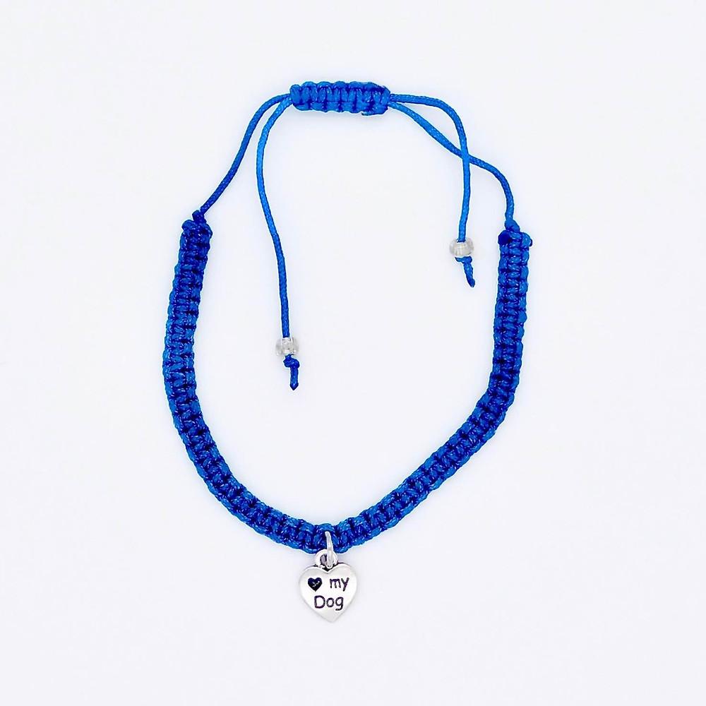 I love my dog charm on a braided bright blue nylon cord.