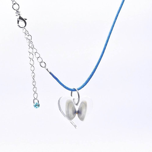 Sea inspired handmade real light blue and white coquina shells in resin heart necklace.