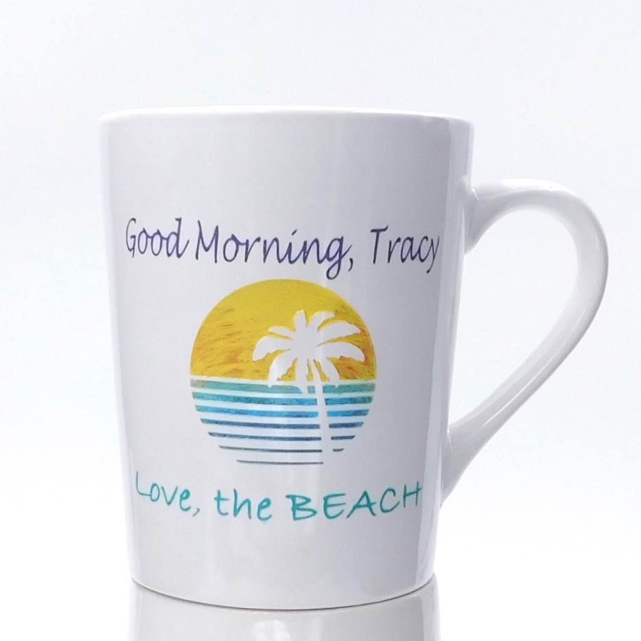 Deep etched personalized sunrise white coffee mug with color fill.