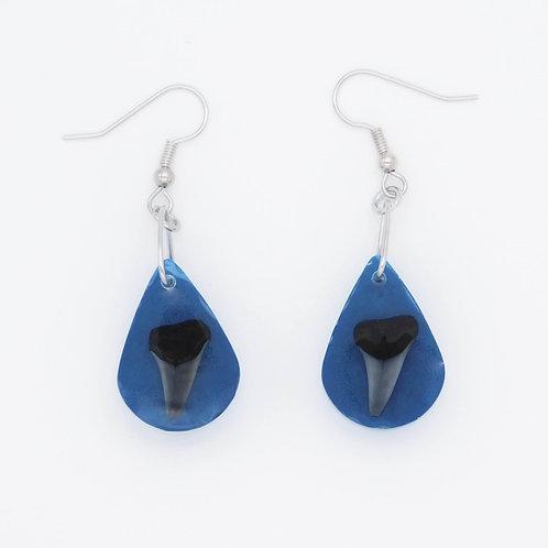 Handmade sea inspired genuine shark teeth embedded in blue lagoon colored resin earrings.