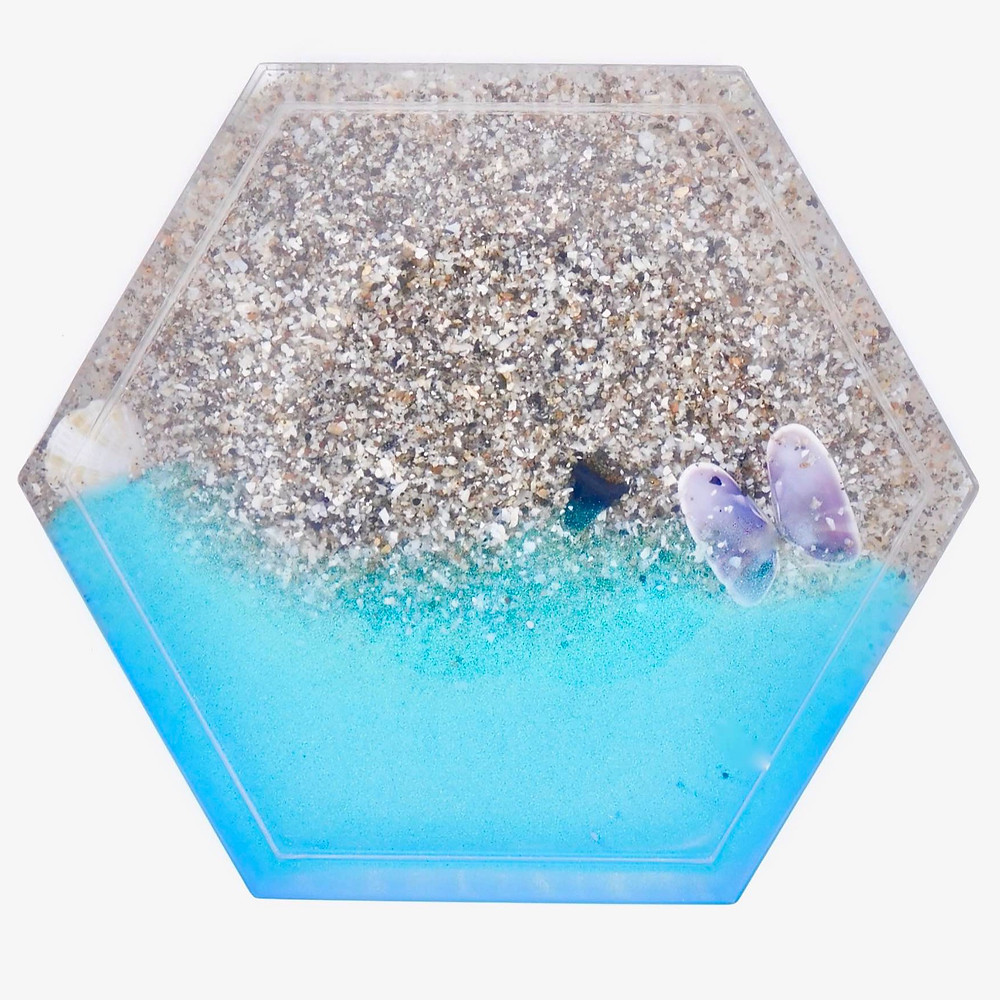 Resin hexagon coaster made with real sand, shells, and shark tooth.