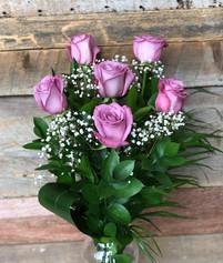6 roses lilas avec vase 61$