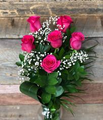 6 roses fushias avec vase 61$