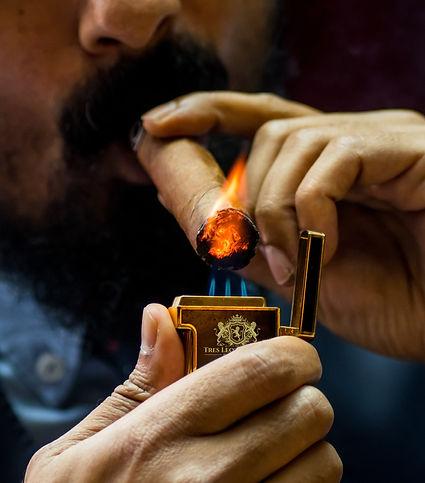 Lighting Tres Leones Cigar