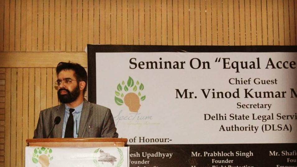 Prabhloch delivering a talk at the Seminar on Equal Access to Justice