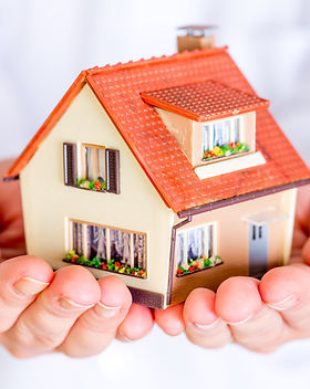 House in human hands on a white backgrou