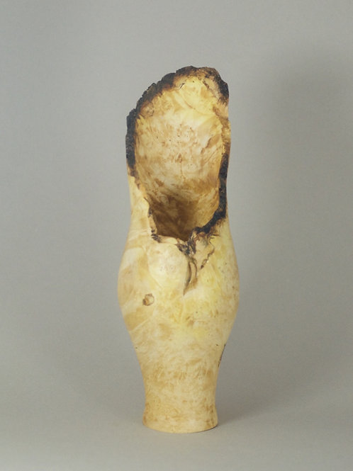 Natural-edge vessel turned from Box Elder Burl