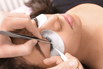 Young woman undergoing eyelash extension