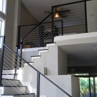 cable railing for a more modern look.jpg