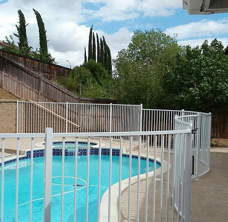 Simple fence with curves to add a flowing look along the pool  #theprofessionalironworks #fence #ironworks #socal #lacounty #riversidecounty