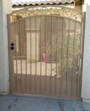 Single gate, matte desert sand powder coat finish with aged bronze lockset #theprofessionalironworks #gates #ornamentaliron # ironworks #san