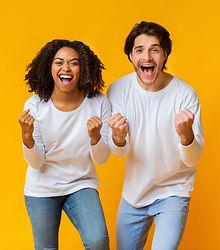 Big Win. Cheeful mixed-race couple celeb