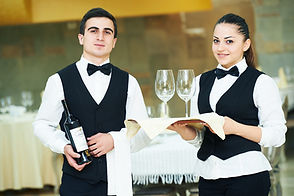 young waiter and waitress at service in
