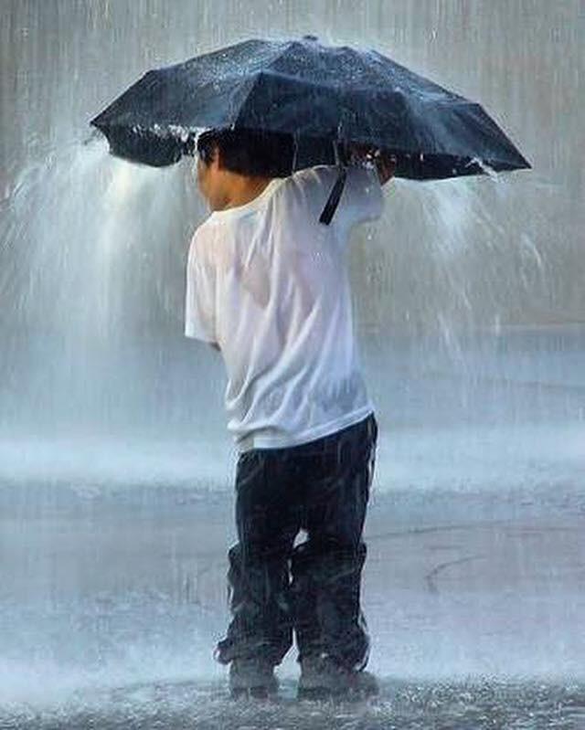 Child under umbrella
