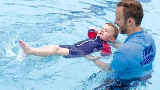 swimming teacher and child
