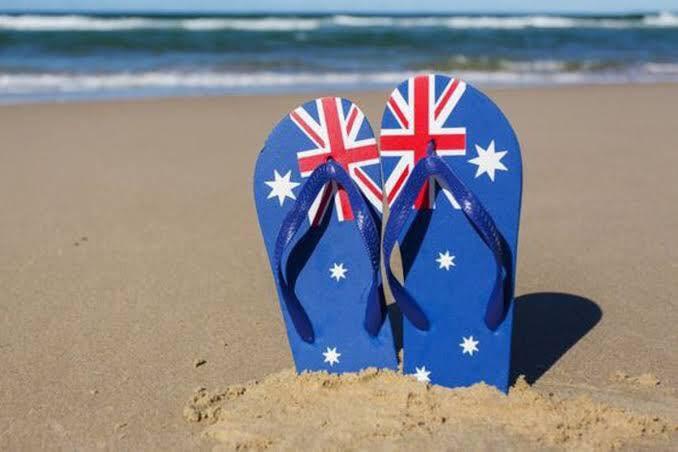australian flag thongs at beach