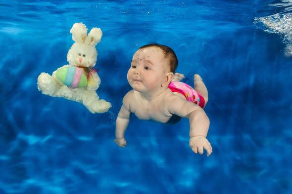 easter bunny swimming baby
