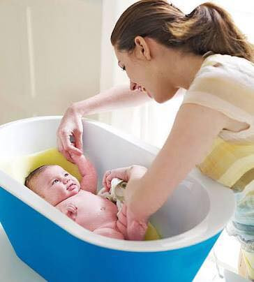 baby in bath with parent